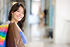Beautiful woman holding bags in a shopping mall